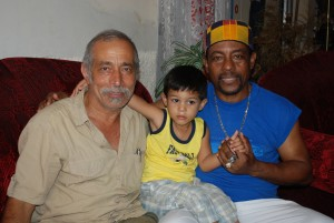 Mo Fini , Candido Fabre and his granson in his house in Manzanillo, Cuba