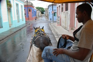 Travelling in a cart around Santiago de Cuba.